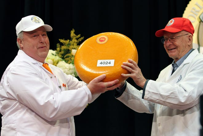 Judges hold up the second runner-up cheese in the World Championship Cheese Contest, Lutjewiinkel Noord Hollandse Gouda from the Netherlands, on March 5, 2020, in Madison.