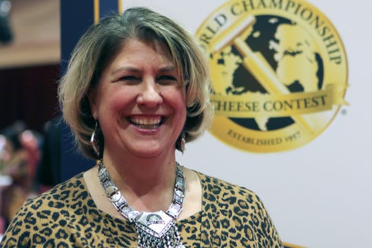 Shirley Knox, from Maple Leaf Cheesemakers, Inc. in Monroe, one of three Wisconsin companies with cheese placing in the top 20 out of more than 3,600 entries at the World Championship Cheese Contest, waited to hear the announcement of the champion cheese on March 5, 2020.