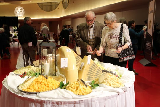 The doors opened and attendees flooded in, heading straight to tables of cheese samples during the World Championship Cheese Contest on March 5, 2020, in Madision.