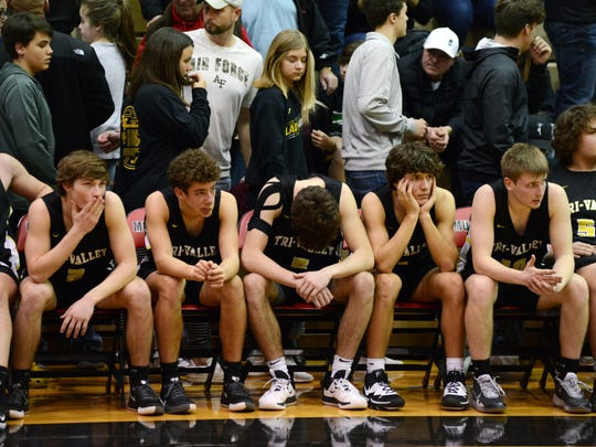 Tri-Valley's Skye Bryan, left, Jalen Goins-Chandler, Keaton Williams, Ty Smith and Luke Lyall watch from the bench as the final minutes tick away in a 61-28 loss to Meadowbrook in a Division II district final on Saturday at the Muskingum University Rec Center.