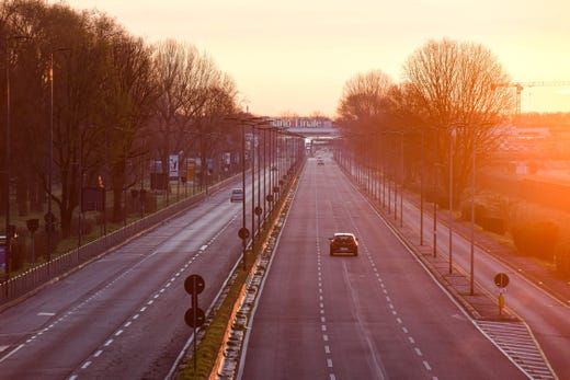 A picture taken on March 8, 2020 shows an empty road leading to Linate Airport in Milan, after millions of people were placed under forced quarantine in northern Italy as the government approved drastic measures in an attempt to halt the spread of the deadly coronavirus that is sweeping the globe. On top of the forced quarantine of 15 million people in vast areas of northern Italy until April 3, the government has also closed schools, nightclubs and casinos throughout the country, according to the text of the decree published on the government website. With more than 230 fatalities, Italy has recorded the most deaths from the COVID-19 disease of any country outside China, where the outbreak began in December.