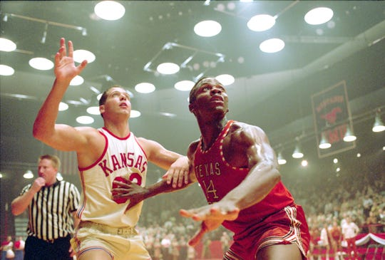 "Derek Luke (right) stars as Texas Western point guard Bobby Joe Hill in the period drama ""Glory Road."""