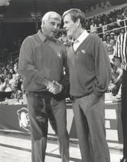 "Competing coaches Pete Bell (Nick Nolte, right) and Bobby Knight (himself) shake hands in ""Blue Chips."""