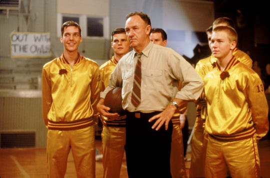 "Gene Hackman (center) stars as the coach of small-town Hickory High in the underdog classic ""Hoosiers."""
