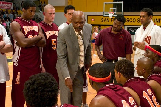 "Ken Carter (Samuel L. Jackson, center) gets real with his players during a game in ""Coach Carter."""
