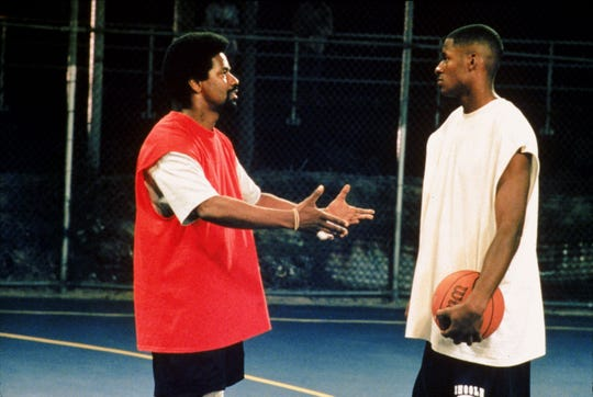 "Jake Shuttlesworth (Denzel Washington, left) is a former hoops star and convicted felon trying to connect with his estranged son Jesus (Ray Allen) in Spike Lee's ""He Got Game."""