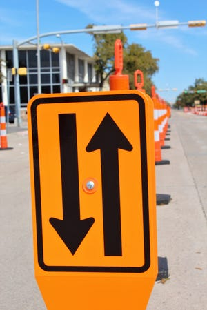 During the coronavirus pandemic, work was done on downtown Abilene streets to fix cracked and missing concrete. The recovery from the pandemic will be a two-way street, with progress working alongside caution for good health.