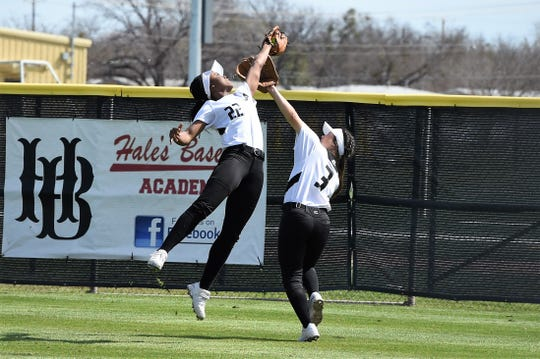 Abilene High center fielder KK Roberson (22) reaches out to catch a fly ball in front of right fielder Teá Jimenez (3) during the District 3-6A game against Hurst Bell on Monday. Roberson scored three runs and had an RBI as the Lady Eagles won 19-1 in five innings.