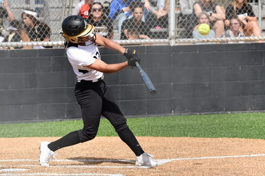 Abilene High's Alyssa Washington (23) hits her second three-run home run of the District 3-6A game against Hurst Bell on Monday. The Lady Eagles won 19-1 in five innings.