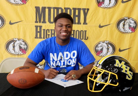 Murphy senior Devonte Murray signs with Brevard College on March 9.