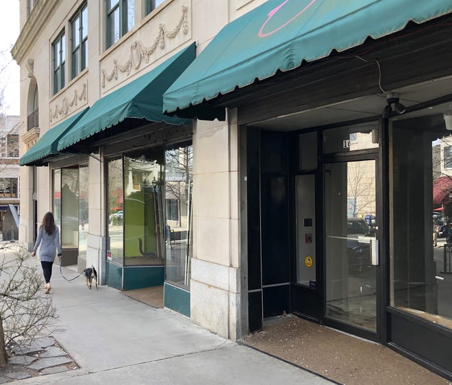 The former street level retail shops are vacant in the Flatiron Building, which is undergoing renovations to transform it into a 71-room hotel. Scaffolding will soon go up over sidewalks as construction continues.