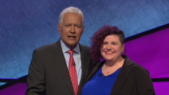"Battle Creek native Michonne Omo with ""Jeopardy!"" host Alex Trebek. Omo was a contestant on the episode airing Thursday, March 12."