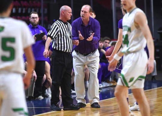 Norwich coach Tom Collier talks with a referee about a call during the first half of Sunday's game. Seton Catholic Central vs. Norwich Boys Basketball, Class B, Section 4 Final, at Broome County Veterans Memorial Arena. Sunday, March 8, 2020.