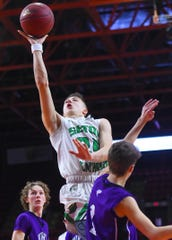 Seton Catholic Central's Brett Rumpel drives to the basket during Sunday's Section 4 Class B final against Norwich at Floyd L. Maines Veterans Memorial Arena. Rumpel had 45 points in SCC's 79-52 victory.