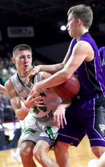 Brett Rumpel of Seton (24), left, looks to control the ball during the first half of action of Sunday's game. Seton Catholic Central vs. Norwich Boys Basketball, Class B, Section 4 Final, at Broome County Veterans Memorial Arena. Sunday, March 8, 2020.