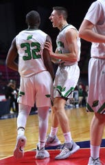 Seton's Marcus Dyes (32) and Brett Rumpel (24) during Sunday's championship game. Seton Catholic Central vs. Norwich Boys Basketball, Class B, Section 4 Final, at Broome County Veterans Memorial Arena. Sunday, March 8, 2020.