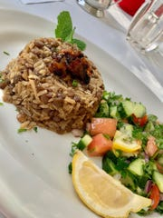 Mujadara: Lentil and rice topped with caramelized onions and served with a vegan salad, a special at La Cita Country Club in Titusville.