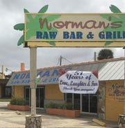 A sign in front of Norman's Raw Bar & Grill announced Monday that the business has been sold after 51 years in Cocoa Village.