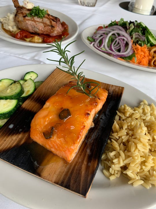Oak Plan Salmon with an apricot and jalapeno glaze, served with zucchini and jasmine rice, at La Cita Golf & Country Club in Titusville.