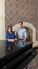 Beatrice Fahel, who owns La Cita Country Club with her sisters, and Justin Belz, marketing and sales at the club, stand in the Mediterranean-style entryway of the clubhouse.