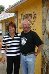 Norman and Carrie Earley stand outside of Norman's Raw Bar & Grill in 2004.