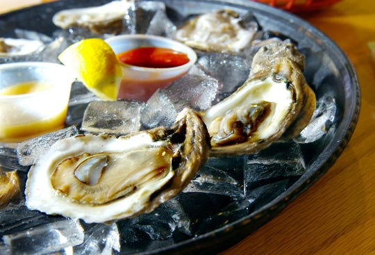 A dozen freshly shucked oysters sit on the bar at Norman's Raw Bar & Grill in Cocoa in this 2009 photo.