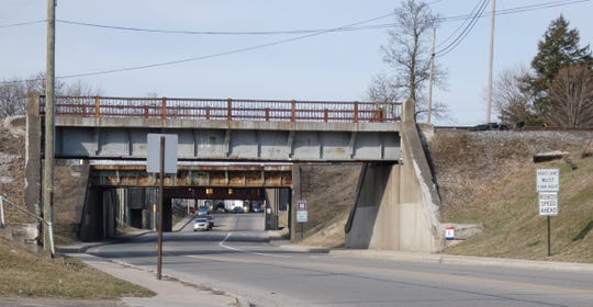 East Mansfield Street was open to traffic Monday after being closed for several hours Saturday. A chunk of concrete fell off the easternmost of three railroad bridges.