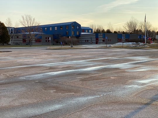 Allen Brook School parking lot is empty shortly before 8 a.m. Monday, March 9. The school was closed due to a coronavirus concern.