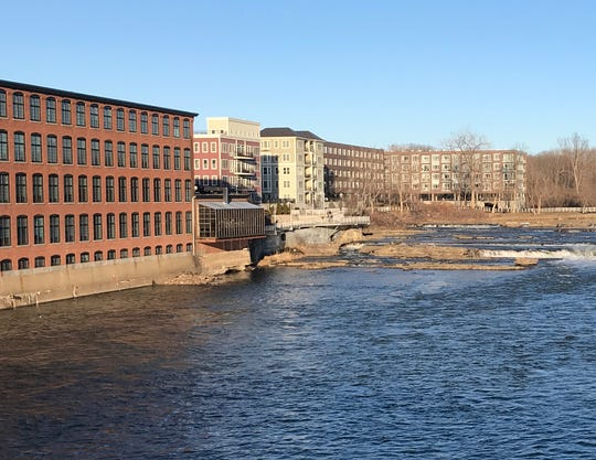 Residences at 40 Winooski Falls Way in Winooski are seen, center, just upstream from the more massive Champlain Mills building on March 7, 2020.