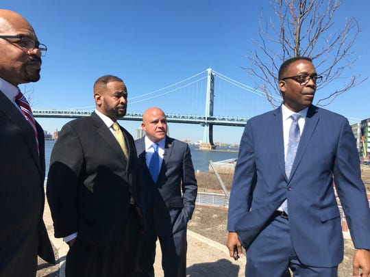 Camden City Council President Curtis Jenkins (left to right), Philadelphia City Councilman Curtis Jones Jr., Camden Mayor Frank Moran and Philadelphia City Council President Darrell Clarke tour the Camden Waterfront on Monday.