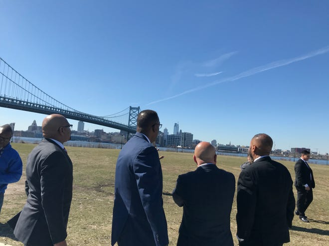 Camden City Council President Curtis Jenkins, Philadelphia City Council President Darrell Clarke, Camden Mayor Frank Moran and Philadelphia City Councilman Curtis Jones Jr. take in the view of from the Camden Waterfront.