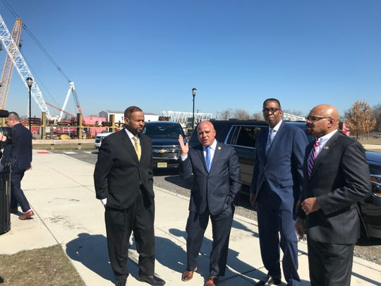 Philadelphia City Councilman Curtis Jones Jr., Camden Mayor Frank Moran and Philadelphia City Council President Darrell Clarke and Camden City Council President Curtis Jenkins (left to right), tour the Camden Waterfront on Monday.