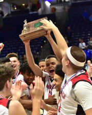 La Salle's Lancers hoist the championship trophy in the 2020 Division I Southwest District Championship, March 8, 2020.
