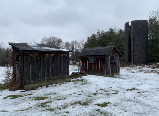The farmhouse outbuildings, including a terracotta silo must also be moved