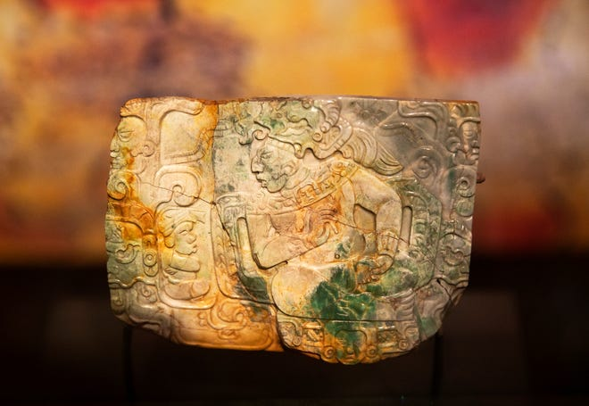 A jade plaque from Nebaj, Guatemala from the late classic period, 600-8800 CE. It's part of Maya: The Exhibition at Cincinnati Museum Center. The exhibition includes over 300 objects from the Mayan people. The civilization dates back to 2000 BC and reached its height in 600 AD. The exhibit will feature variety of objects from daily life and the innovations of the Mayan people who lived in the heart of the rainforest. Photographed Monday, March 9, 2020.