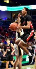 Julian Mackey of Lakota West takes to the air in the lane to lay in a basket for the Firebirds in the 2020 Division I Southwest District Championship, March 8, 2020.