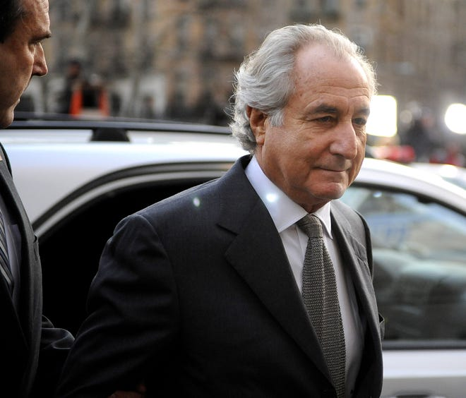 Financier Bernard Madoff arrives at federal court on March 12, 2009 in New York City. Madoff entered a guilty plea on 11 felony counts which under federal law can result in a sentence of about 150 years.