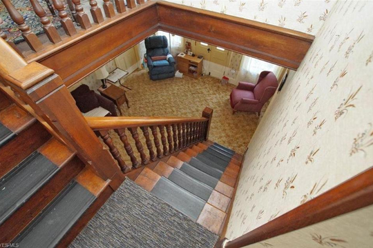 A walnut staircase is one of the features of the historic farmhouse in Hudson, Ohio