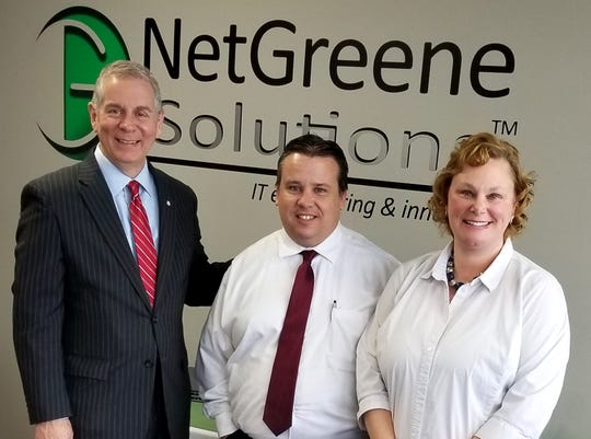 Clarksville Mayor Joe Pitts, left, celebrates the grand opening and expansion of NetGreene Solutions with owners Scott and Leigh Ann Greene.