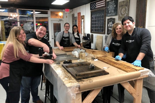 Board and Brush, which helps visitors create custom wood signs, opened in Somerville on Dec. 14.