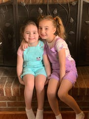 Jade DeLucia (left) and her sister Catalina bond during a family trip to Colorado. Jade, who was left blind after a battle with the flu in December, regained her sight late January.