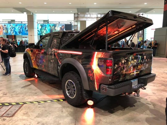 The Star Wars Raptor, a 2010 Ford Raptor, is decorated with images of Darth Vader, storm troopers, and the characters from the original trilogy. In the back is a recreation of Han Solo frozen in carbonite.