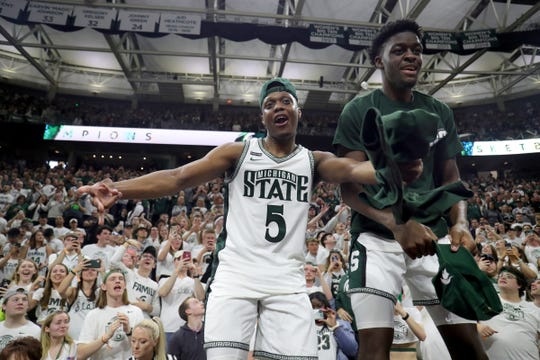 Michigan State's Cassius Winston, left, and Gabe Brown celebrate the 80-69 win against Ohio State on Sunday, March 8, 2020 at the Breslin Center.