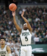 Michigan State's Cassius Winston hits a 3 during the 80-69 win against Ohio State on Sunday, March 8, 2020 at the Breslin Center.