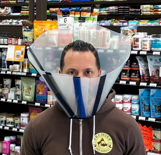 Mike Palmer, 43 and owner of Beverly Hills-based Premier Pet Supply, appears with a dog cone around his neck in a photo later posted to the company's Facebook page.