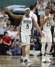 Michigan State guard Cassius Winston waves to fans as he leaves the court form the last time MSU's 80-69 win over Ohio State on Sunday, March 8, 2020, at the Breslin Center.
