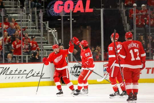 Detroit Red Wings center Robby Fabbri, left, celebrates with teammates after scoring in the first period against the Tampa Bay Lightning on Sunday, March 8, 2020, in Detroit.