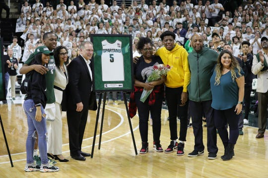 The families of Michigan State guard Cassius Winston and coach Tom Izzo pose during the senior day ceremony after MSU's 80-69 win over Ohio State on Sunday, March 8, 2020, at the Breslin Center.