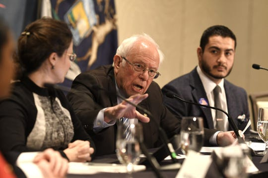 Presidential candidate Sen. Bernie Sanders speaks to health officials about the corona virus outbreak as Allison Galvani, left, and Dr. Abdul El-Sayed, right, listen at the Westin Hotel at Detroit Metropolitan Airport in Romulus on Monday, March 9, 2020.
