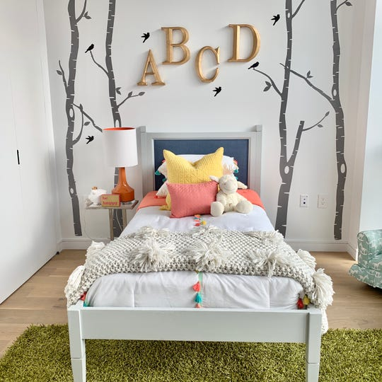 Gray paired with bright colors helps to make this children's bedroom both fun and mature.